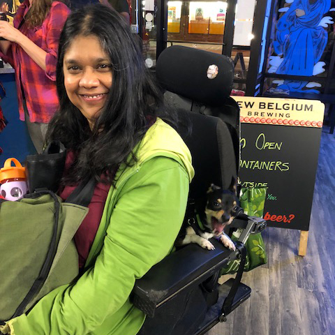 """- Priya RayPriya Ray has been a long time member of the DIY community as a musician and artist. In 1999 she fell off a skateboard ramp that was a DIY space for bands. She sustained a T12-L1 spinal cord injury. When faced with the decision of what she wanted to do as person living with a disability she decided she wanted to keep playing music. When asked why she chooses to continue to create what she does with the DIY ethic she tells people """"because DIY is about community and when I became disabled I needed to be part of this community more than ever"""" Today she has started a non-profit called DIYabled (Diyabled.com) to inform people about the civil rights of People Living with Disabilities (PLD)."""