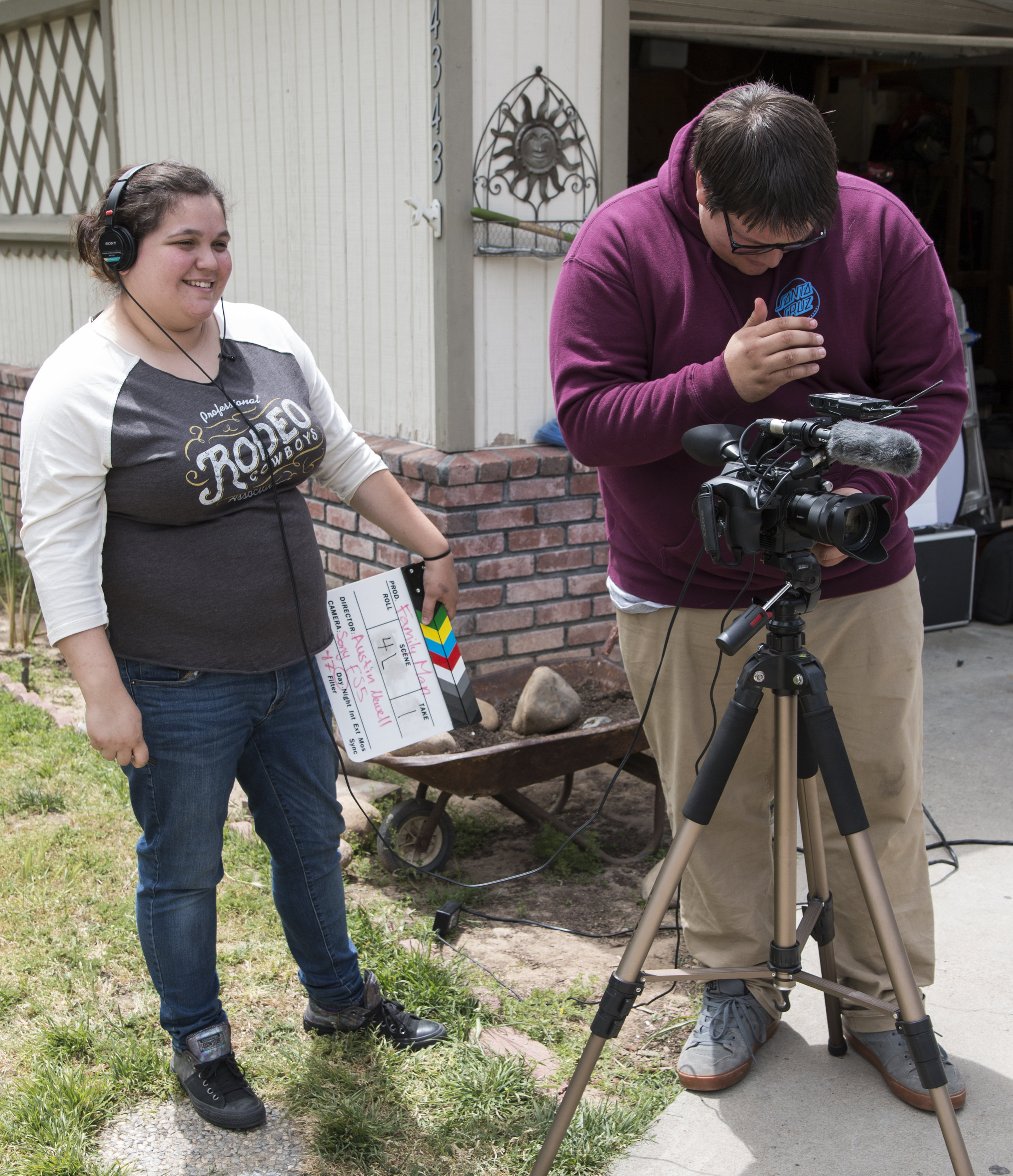 Austin and Jess with camera and clapboard.JPG