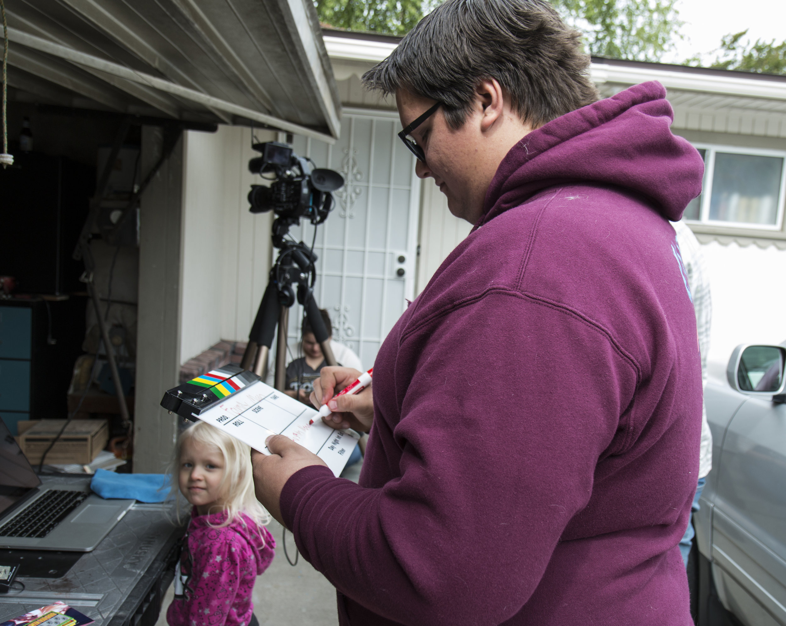 Austin filling out clapboard.JPG