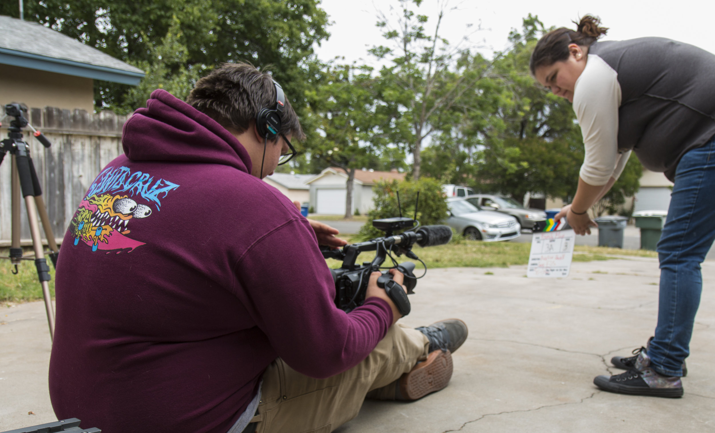 Austin filming on ground with clapboard_2.JPG