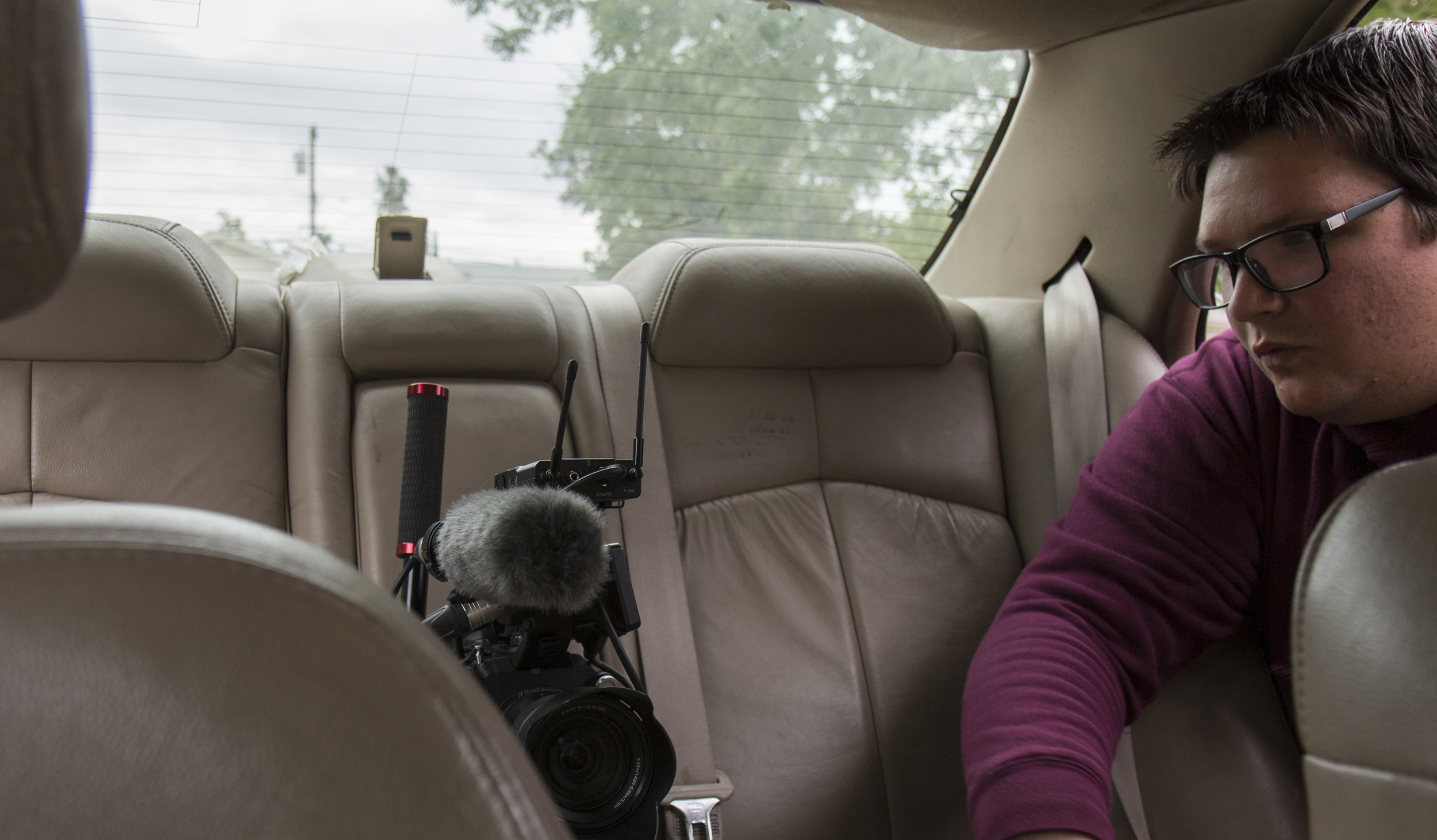 Austin setting up FS5 in back seat.JPG
