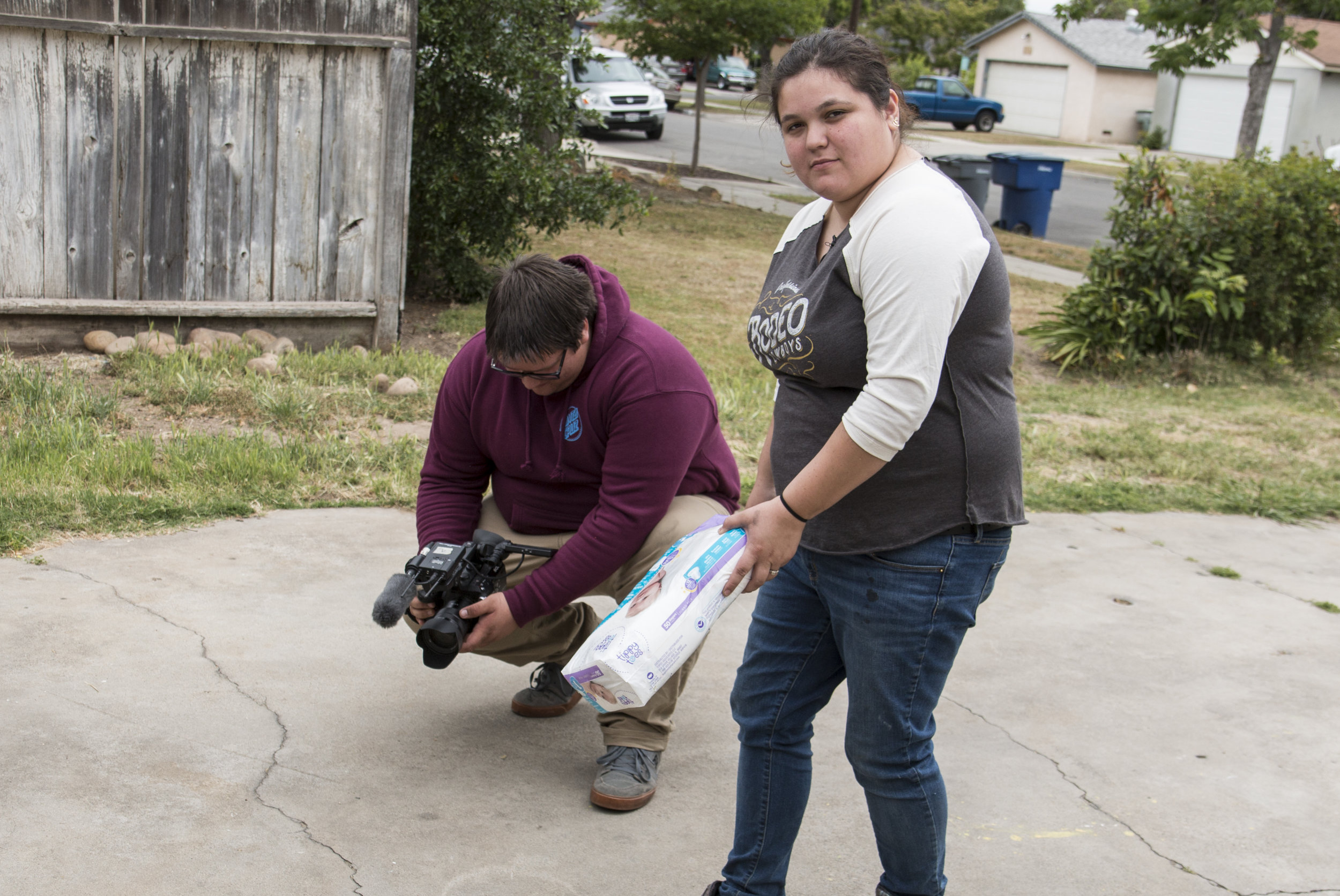 Jess and Austin filming diapers.JPG