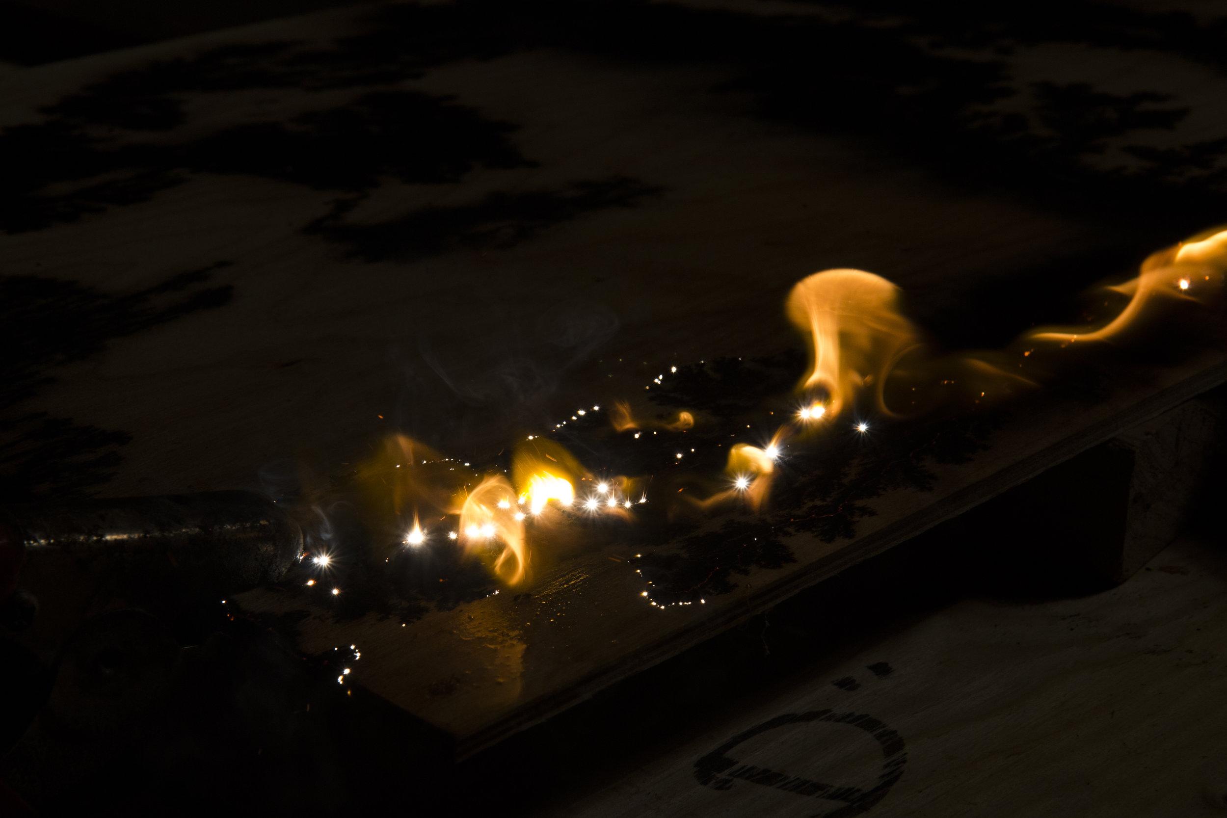 wood burning with lightning