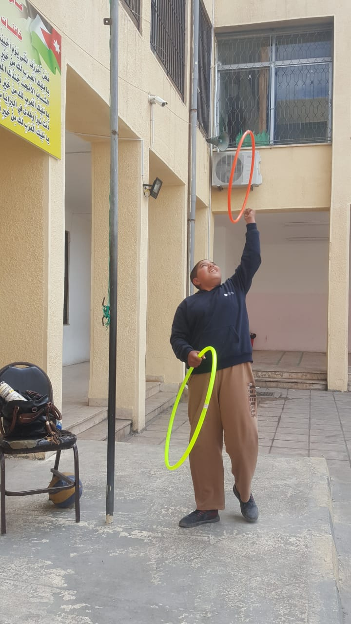 MECI-TSF 21.04.2019 Second Beginner student playing with hoops.jpg
