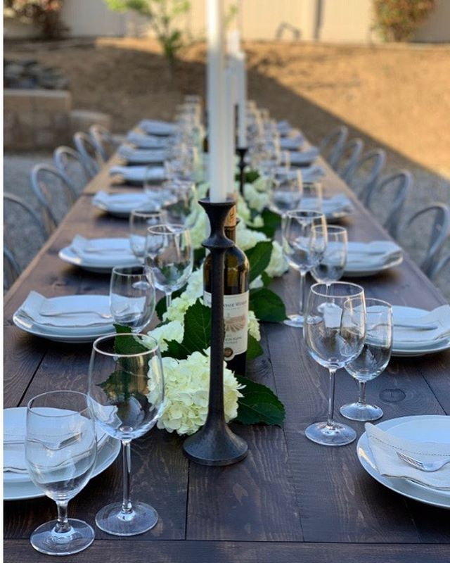 Family style table set up. I love the look of one long table. . . . #rusticweddingdecor #wedding  #tablescapes #familydinner #photography #dinnerparty #bridalshower #babyshower #rehearsaldinner #venuedecor #rustictables #farmtable #tables