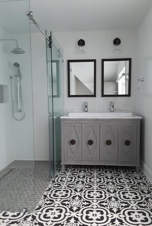 - Mosaic floor tileDouble vanity sinkZero threshold shower