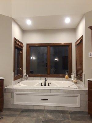 - Marble tile around tubCustom door for easy access