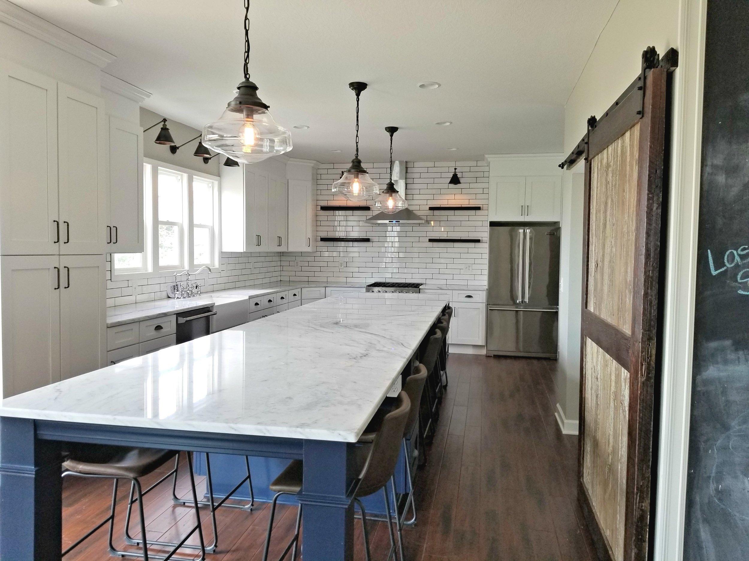 - Custom barnwood door divides office nook from kitchenCustom marble countertop Custom barnwood floating shelvesNew lighting and plumbing