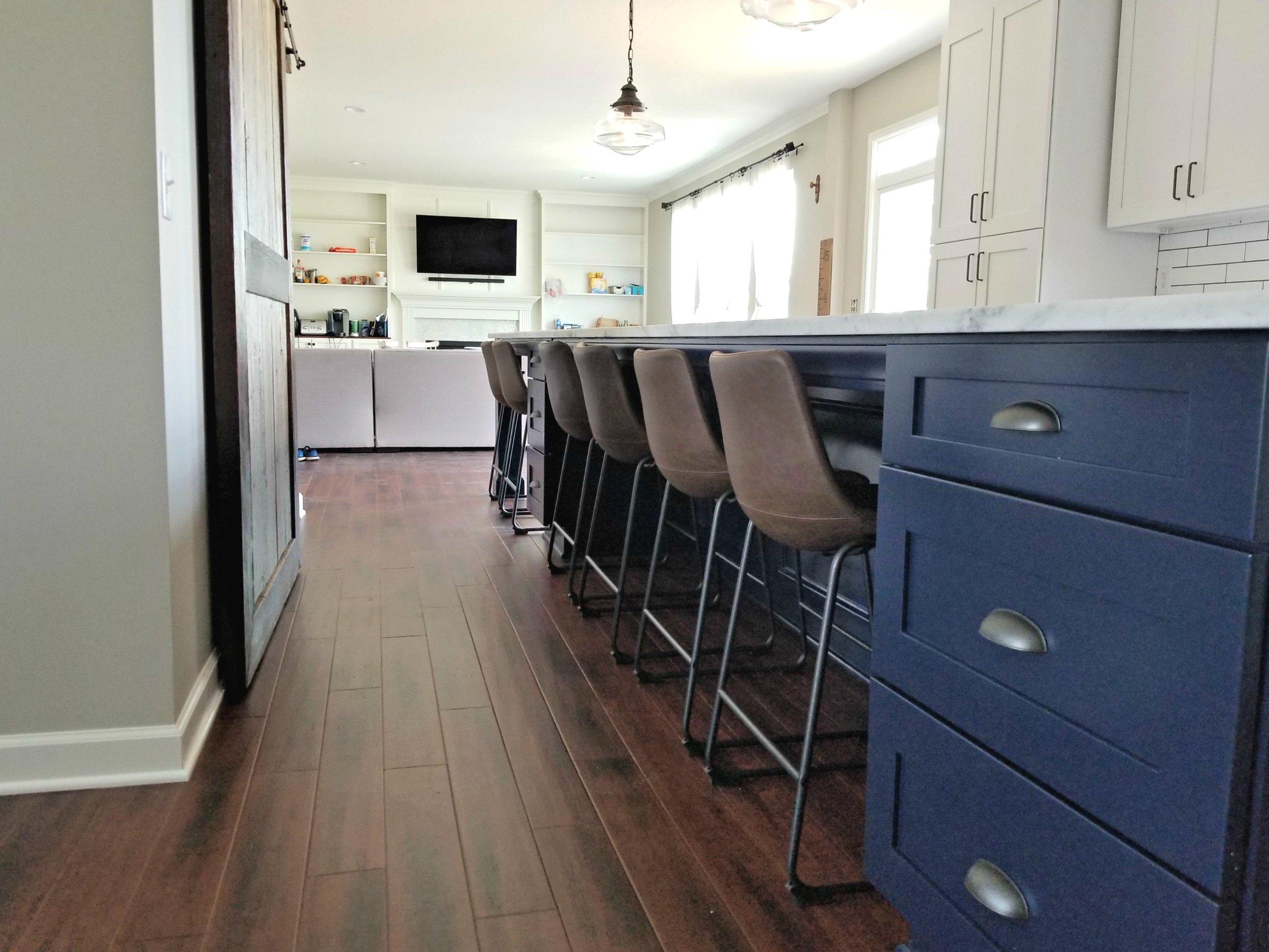 - Custom installed and painted 17-foot islandHardwood floors