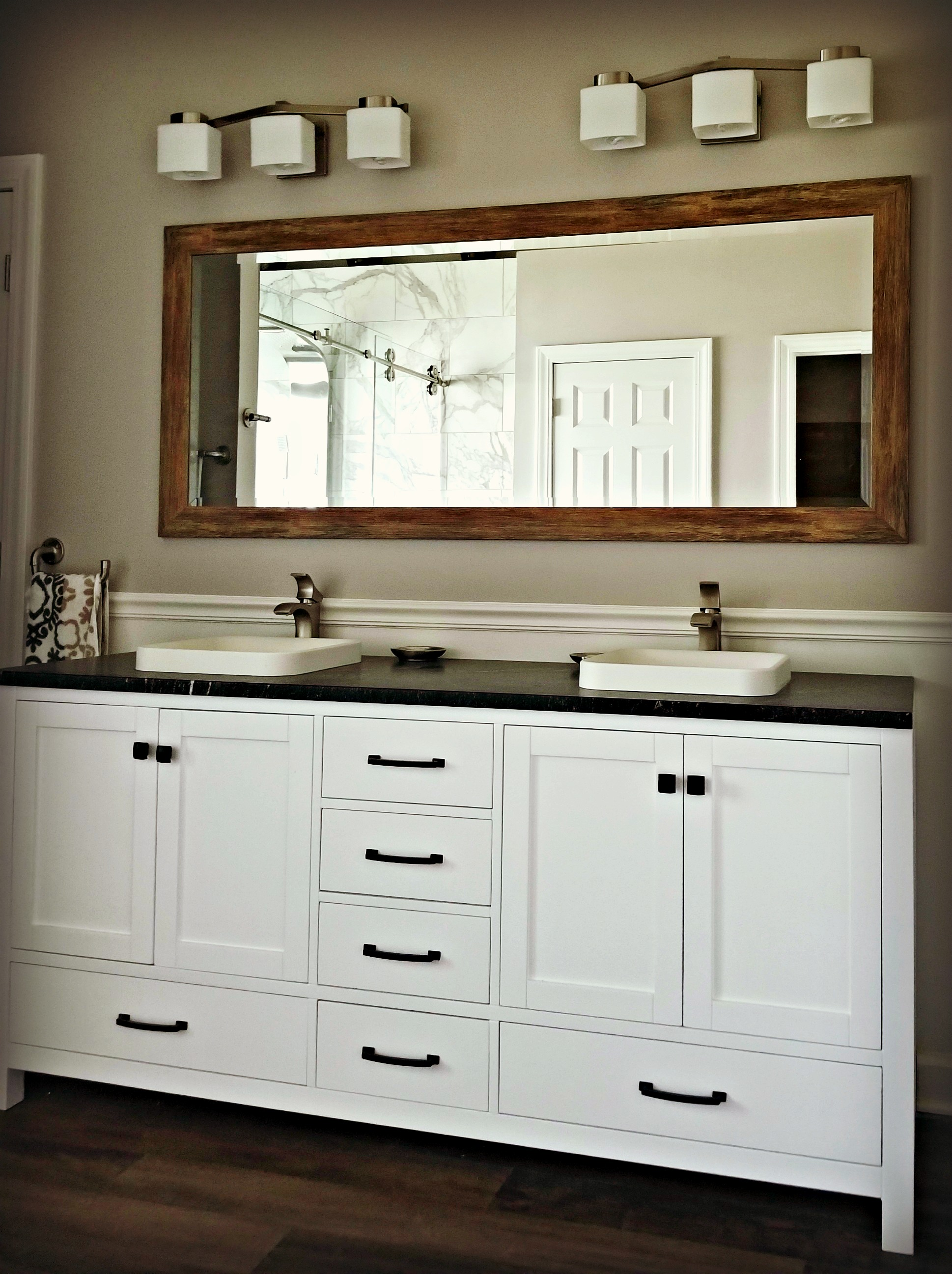 - Double vanity and sinksBrushed nickel hardwareDark granite countertop