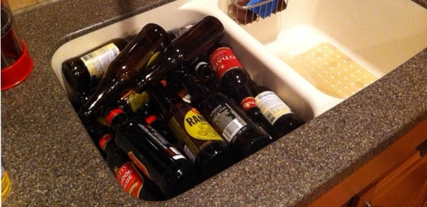This posse of beers assembled to help rescue a bottle cap which slipped down the sink..