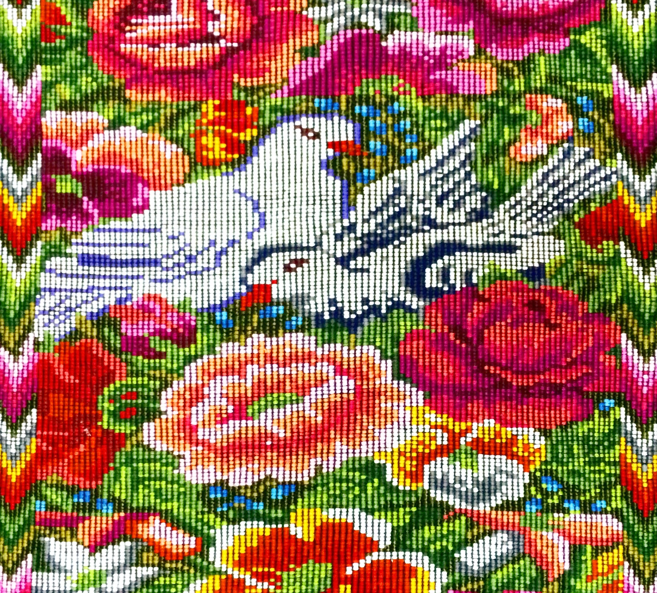 The huipil from Chichicastenango is characterized by colourful floral, birds and geometric patterns