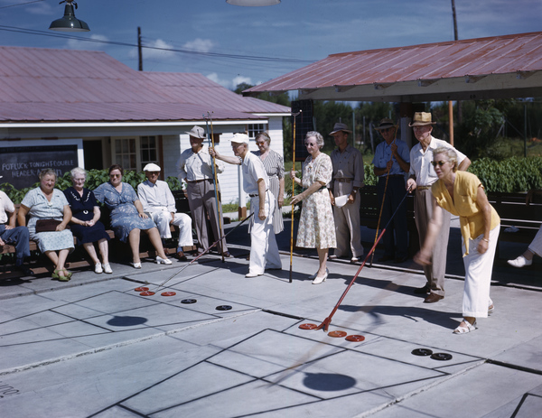 Wily retirees compete in a game of shuffleboard in Sarasota, Florida