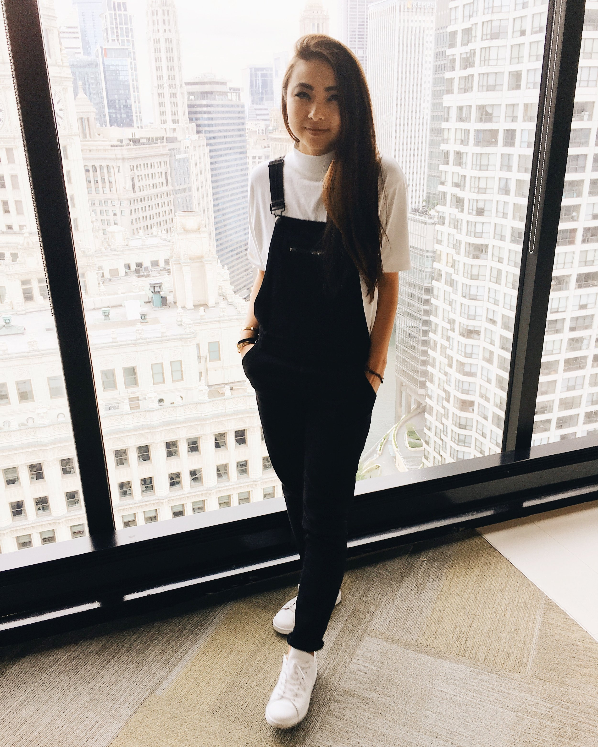 Ginger wears Jack Turtleneck top,  Brandy Melville ; overalls,  Second Skin Overalls ; sneakers,  Adidas .