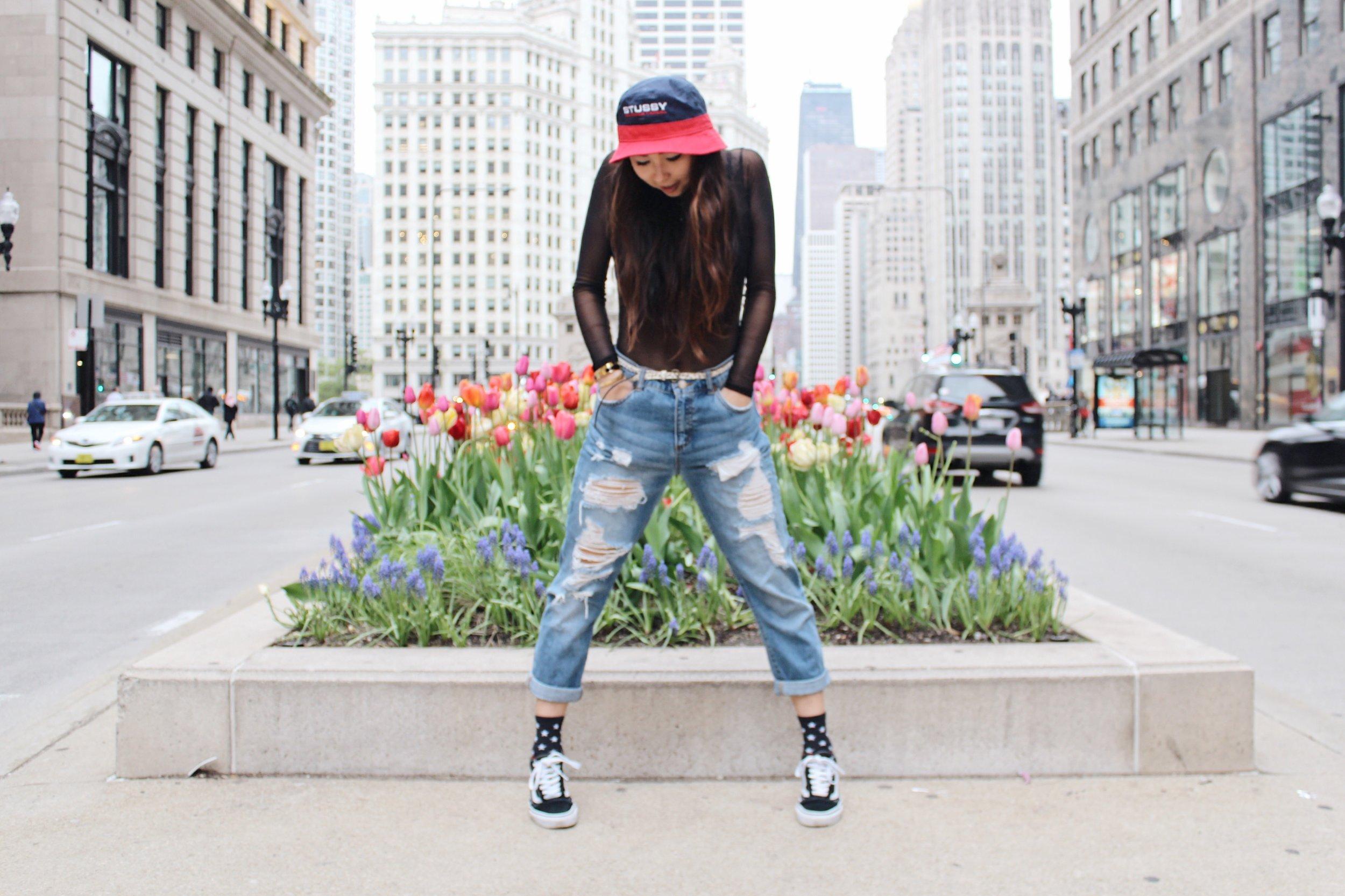 Ginger wears bucket hat, Stüssy ; boyfriend jeans,  Tommy Hilfiger ; socks,  Stance ; sneakers,  Vans .