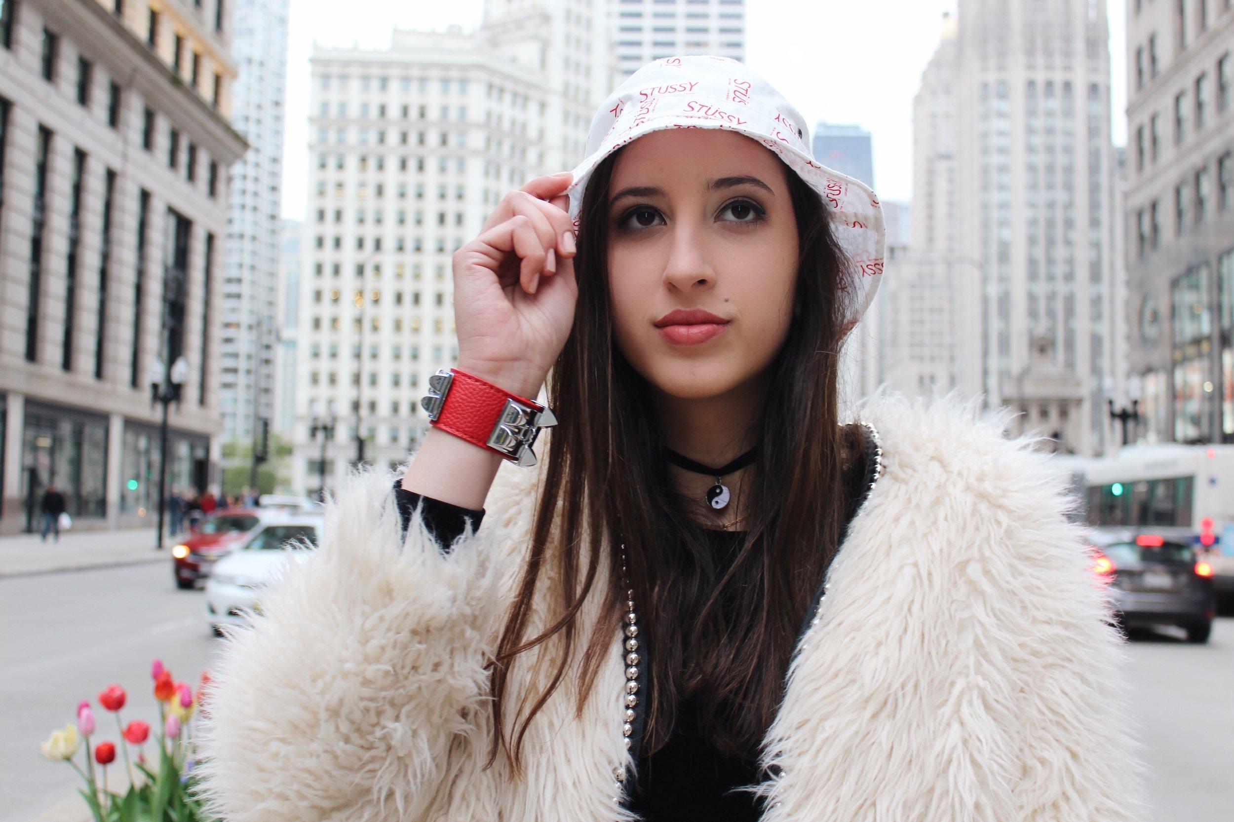 Amanda wears Collier de Chien Bracelet ,  Hermès ; fur coat,  Forever 21 .