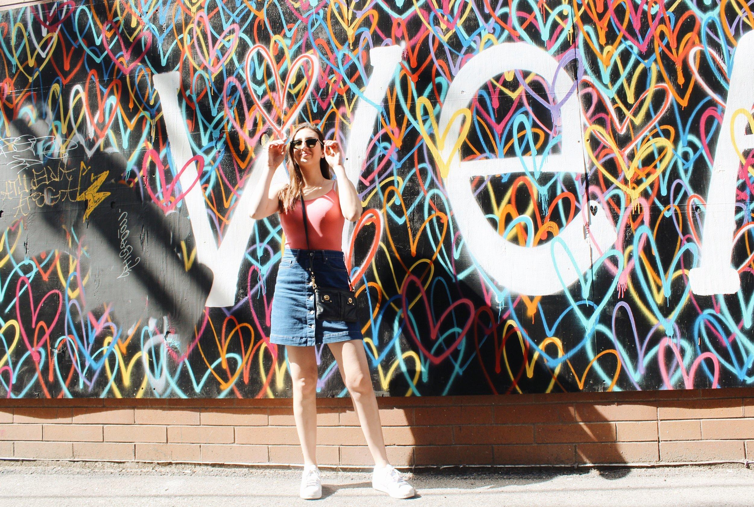 Amanda wears sunglasses,  R  ay-Ban ; tank top,  Urban Outfitters ; skirt,  Gap ; sneakers,  Adidas .