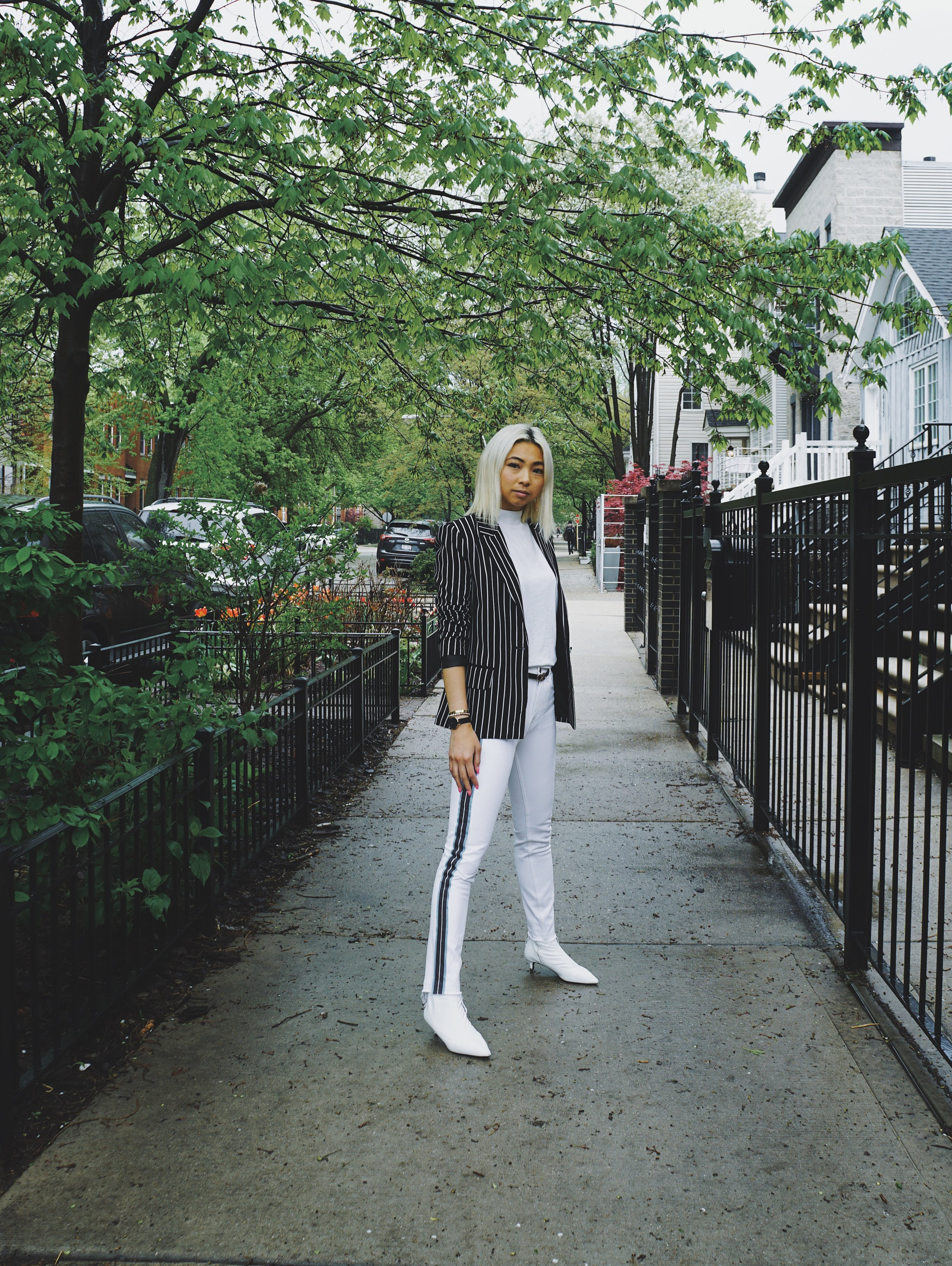 Ginger wears Monki Tailored Popper Detail Stripe Blazer,  Asos ; turtleneck top,  Calvin Klein ; Ceylon Leather belt,  Salvatore Ferragamo ; Karolina High-Rise Crop Jean,  GRLFRND ; Marilyn Kitten Heel,  Free People .