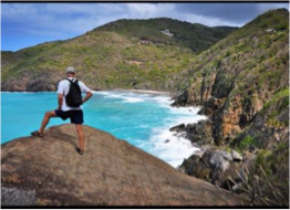 SHARK BAY  (TORTOLA)   Extending over 18.4 acres from the ridge of Anderson Point to the bay sitting at the Mount Healthy's base, Shark Bay is a rocky beach shaped by the north Atlantic swells softened by the offshore coral reef and limestone pavement.