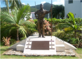 THE NOEL LLOYD POSITIVE ACTION MOVEMENT PARK     The symbol of the population's mobilisation, led by pioneer Noel Lloyd, against the Bates Hill Agreement, under which locals would have not been allowed to access the area, except for those working there as a servant. The people's struggle and determination led to the FCO agreeing to buy back leases of Wickham's Cay in 1970, and is immortalised in this park by a statue of Noel Lloyd and a commemorative plaque.