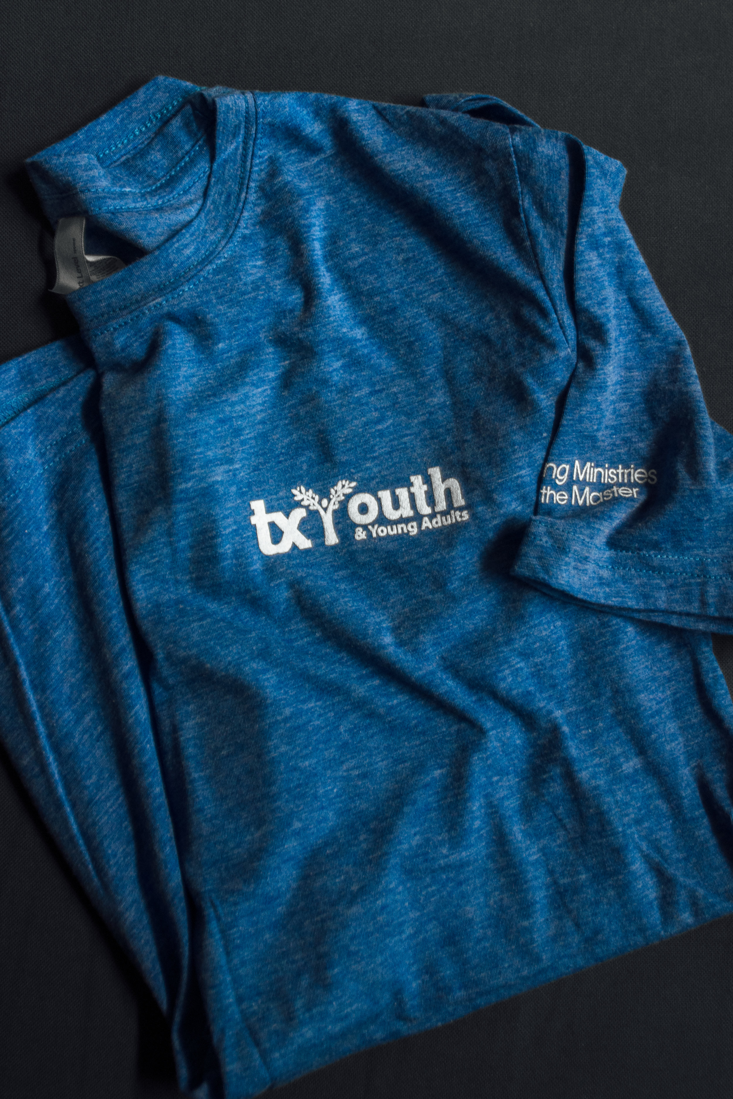 TX YOUTH -  MORE COMPASSION TEE | $10.00