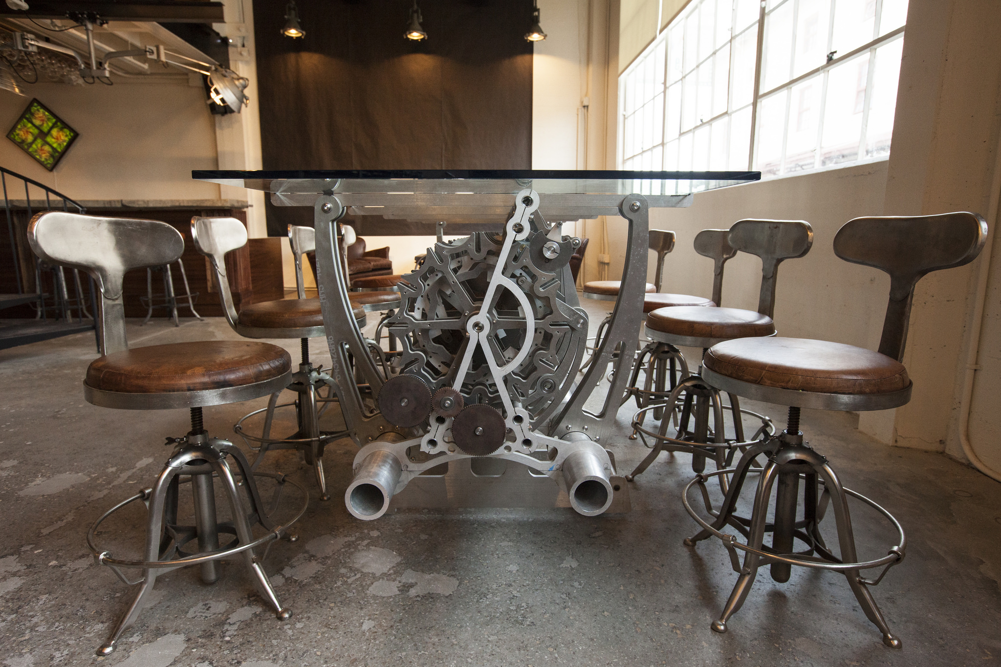 Originally the blacksmith and machine shop for Fort Mason, our design brings a modern spirit to the 1930's era history of the space. Vintage stools and historic concrete floors speak to the original machine-shop space of the space. While a palette of leather, walnut, and metal bring the 30's into focus, as the modern artifacts of the Long Now bring us into the present.