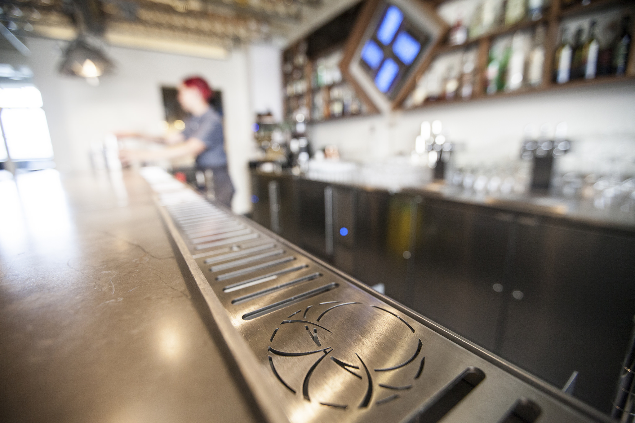 In the bar drip tray, we designed a custom Longnow logo among the drainage.