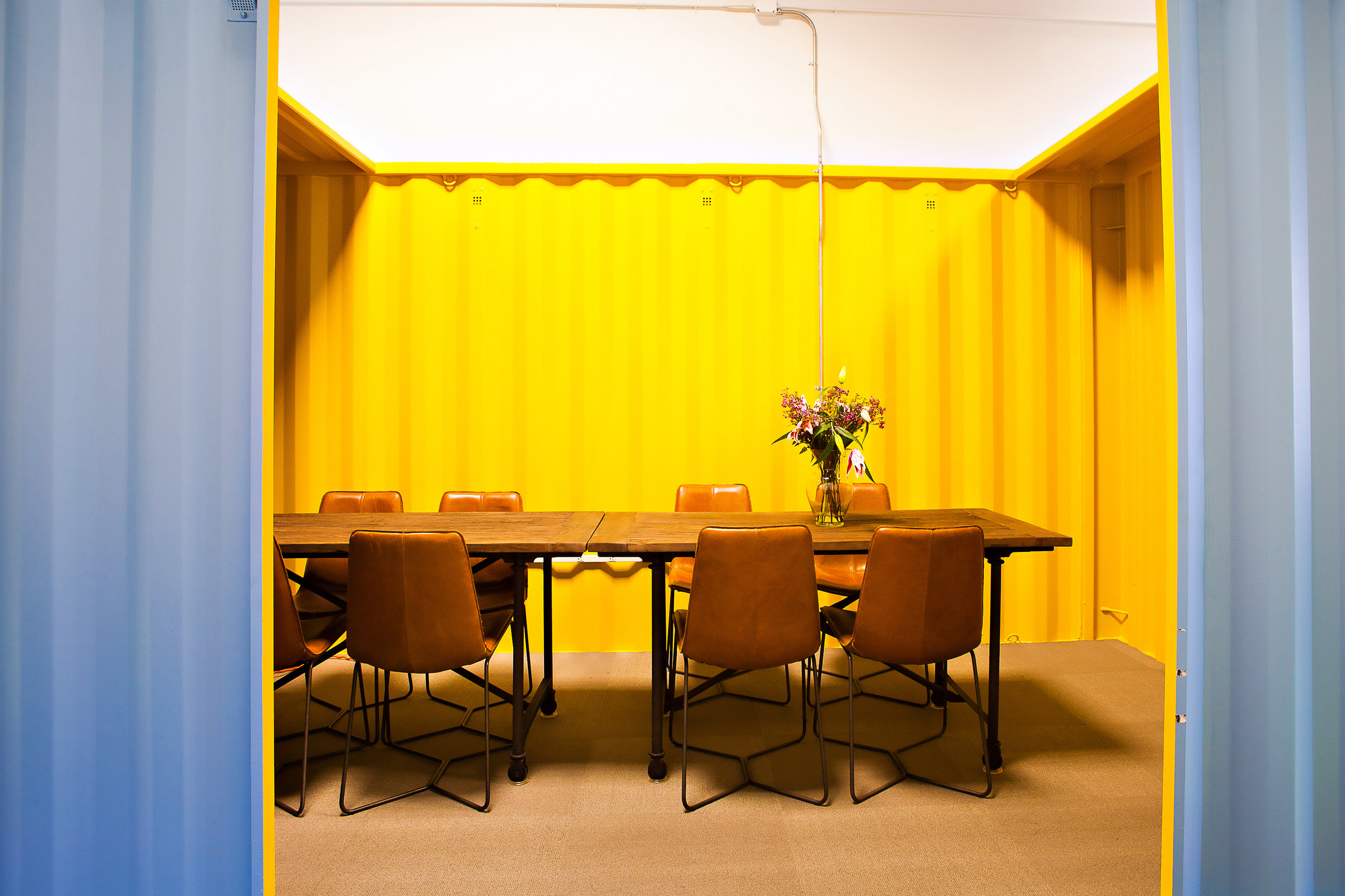 Fashioning cozy meeting rooms out of shipping containers proved to be an affordable solution compared to building out individual spaces. (Photo Credit: Kathleen Harrison)