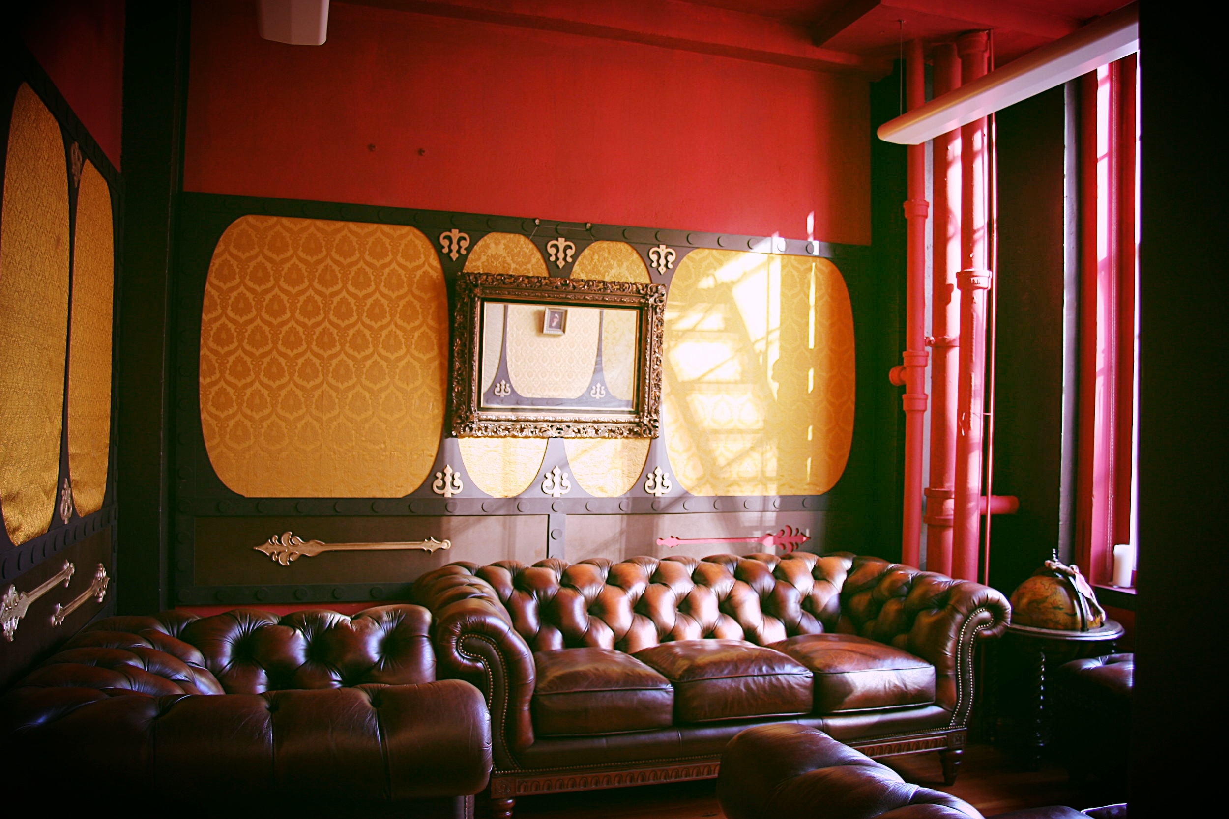 The secret room's furnishings, big,plush leather sofas, were acquired used from a Craigslist poster.