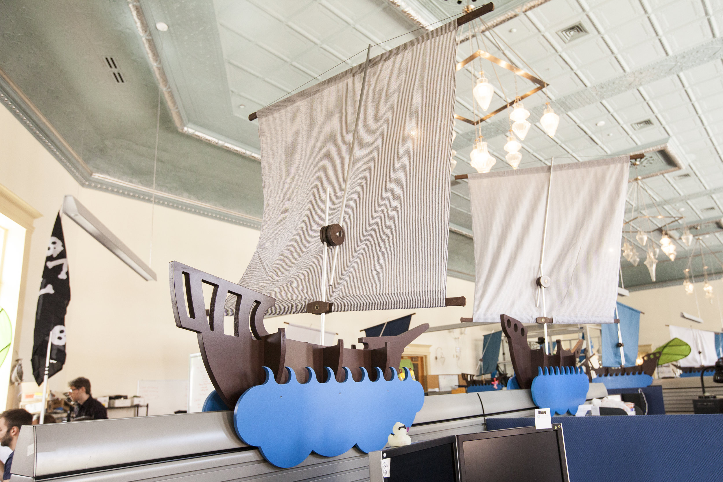 The ship sun shades sit onto the existing desk particians.
