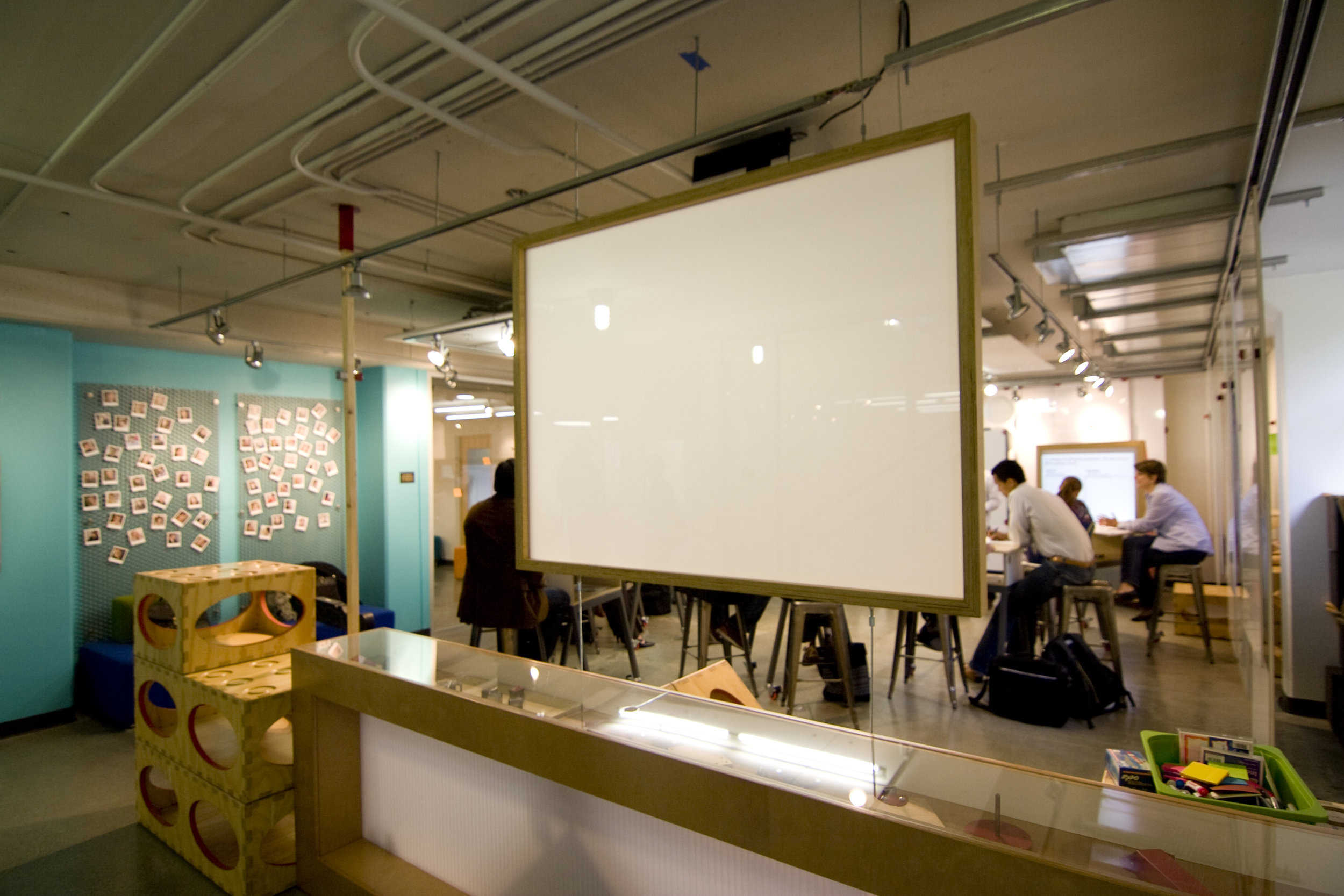 Another projection screen, this one hanging from the ceiling and meant to be viewed from both sides.