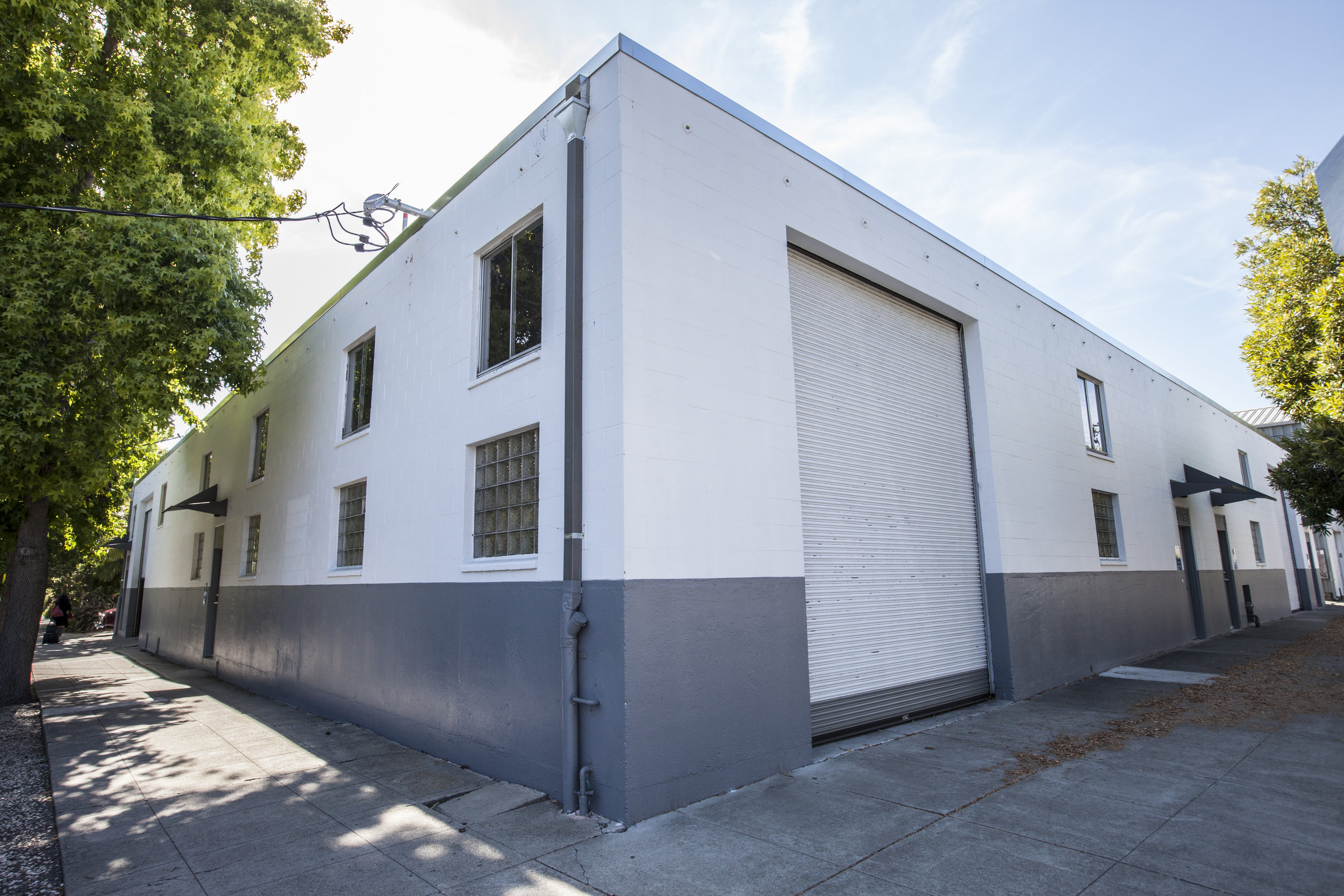 This commercially zoned warehouse on the corner now has a clean and cared for exterior appearance. Being a private facility (not commercial)we wanted to keep a low profile, basic exterior appearance.