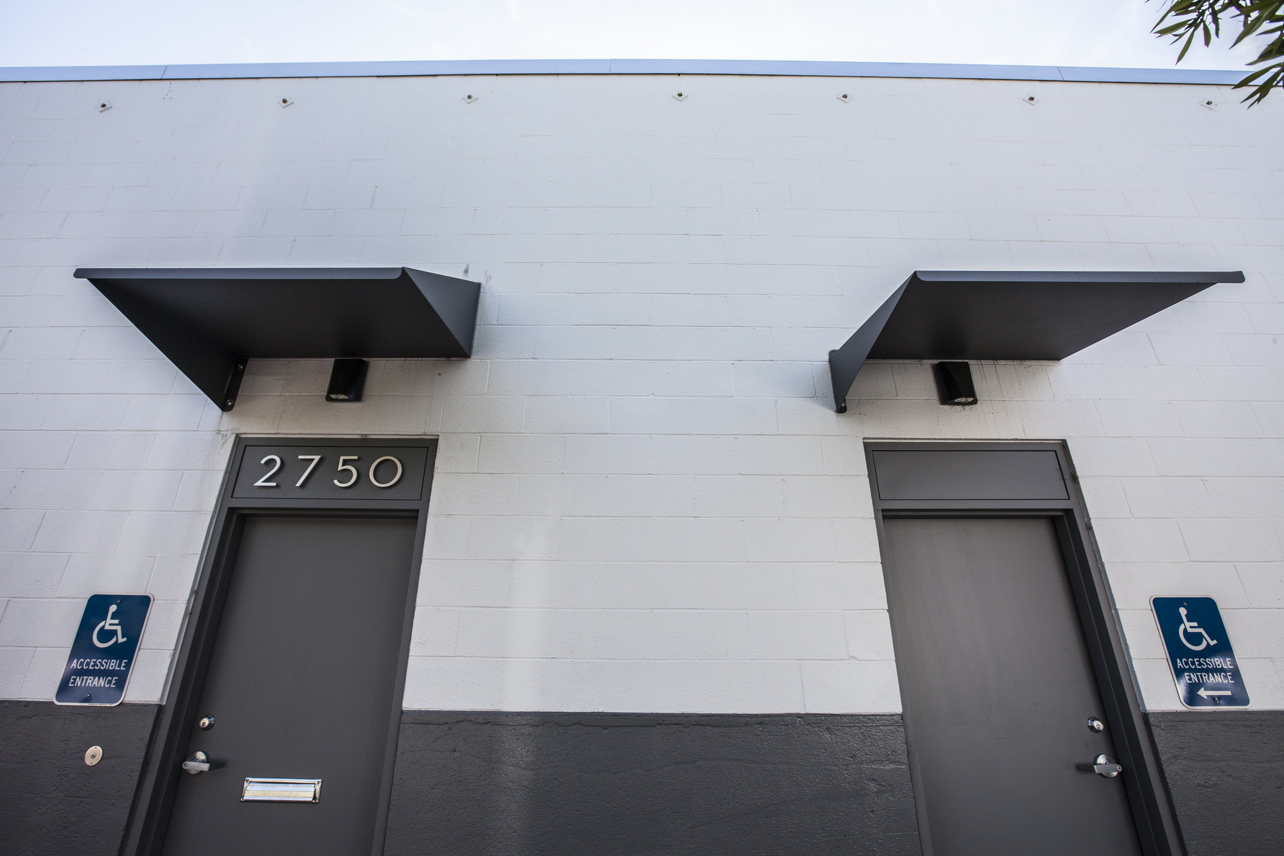 Required awnings and numbers were kept simple and descrete with a bit of fun, modern style.