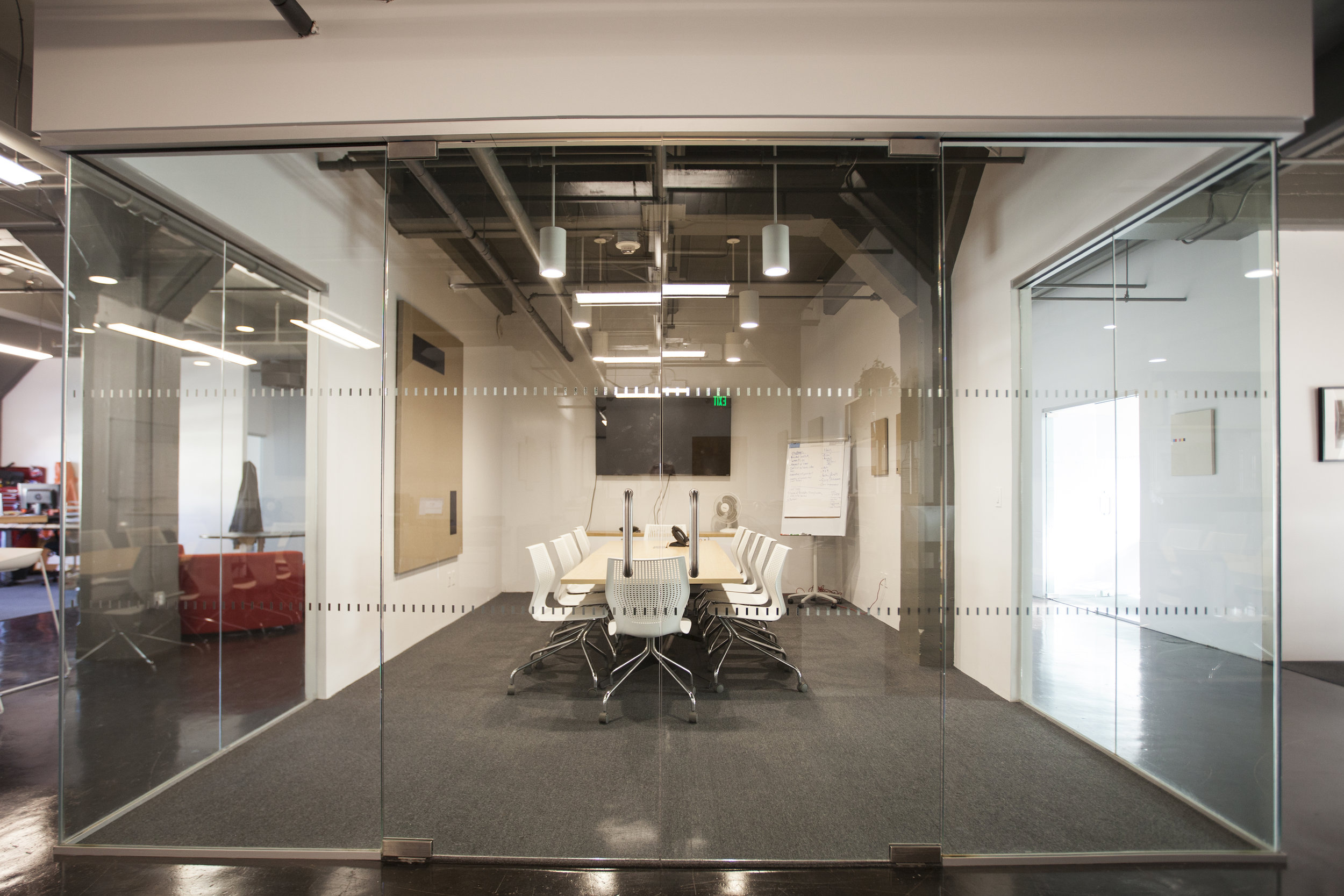 The walls were replaced with glass to open the space with light and create space within the office.