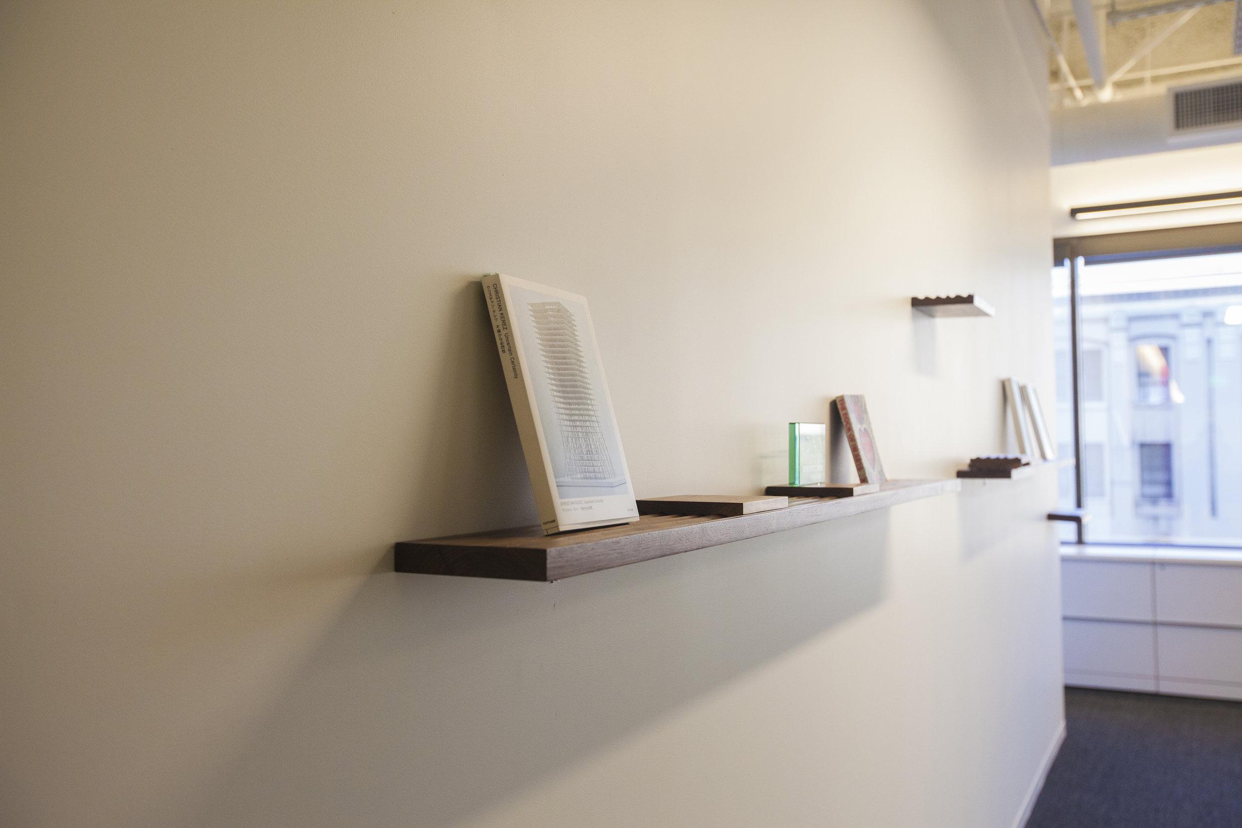 Beginning the layout, the cantilevering shelves arranged decoratively along the wall.
