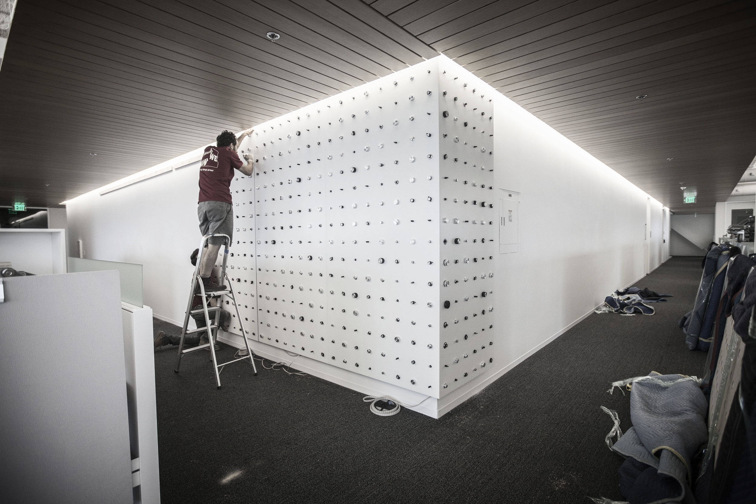 Created in separate 4ft x 8ft panels, the installation hanging was done with a meticulous precision to assure the whole piece looked like one seamless unit.