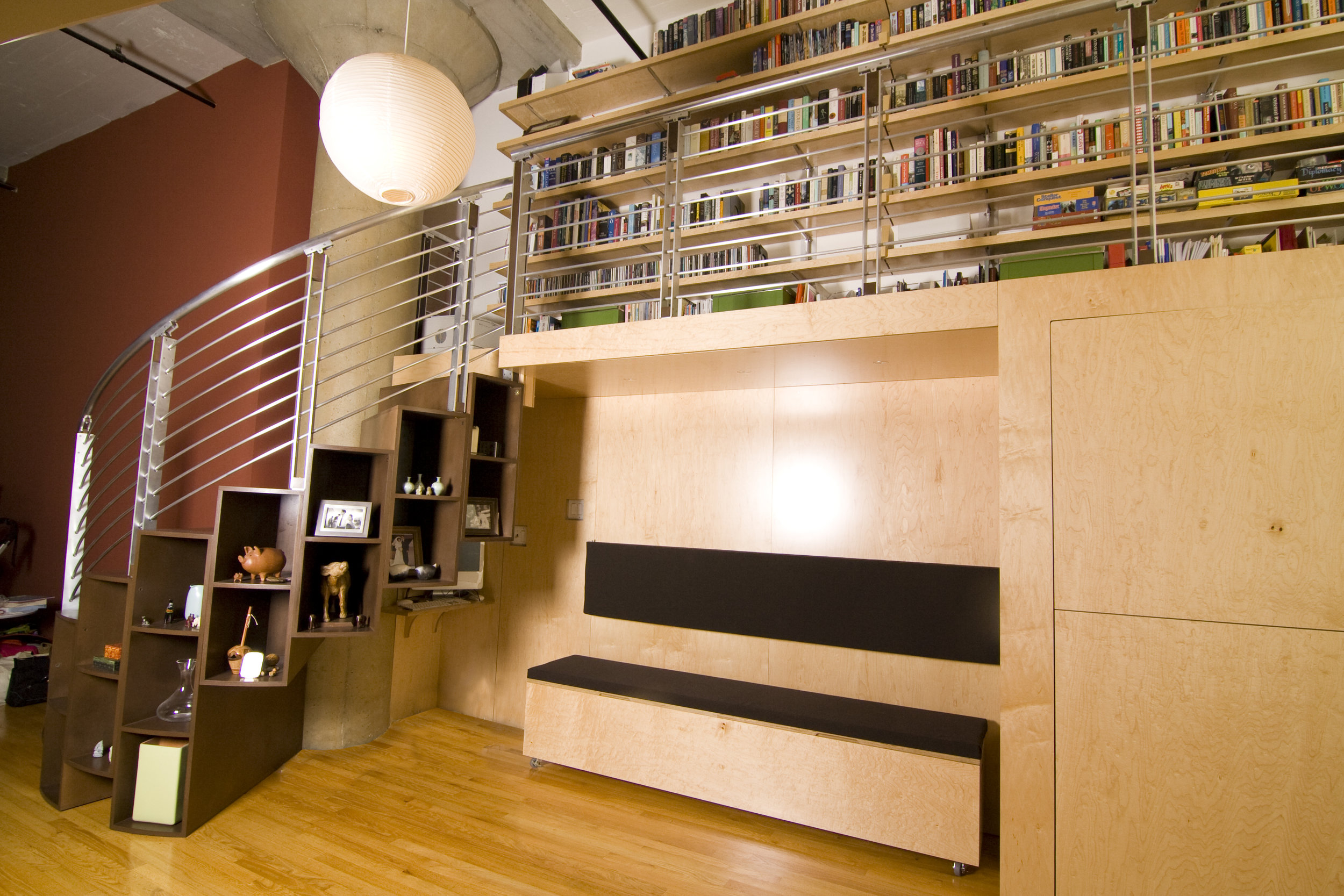 The entire structure was delivered in just a few large units, keeping the installation time to a minimum.The lip of the rolling bench flips up to hold more storage and the flip down desk is illuminated by lights embedded in the above ceiling.
