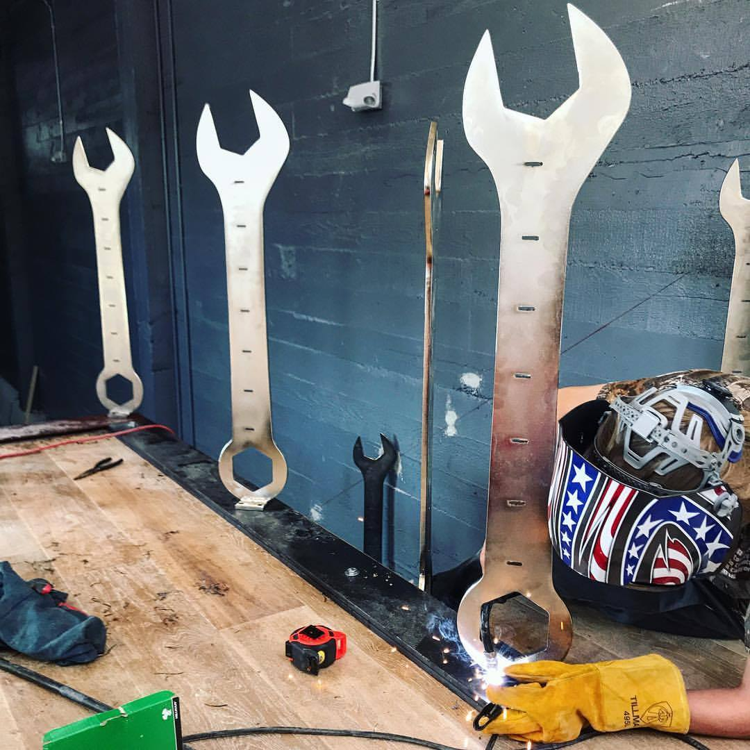 Welding up the wrenches onsite.    photo courtesy of Project Wreckless.