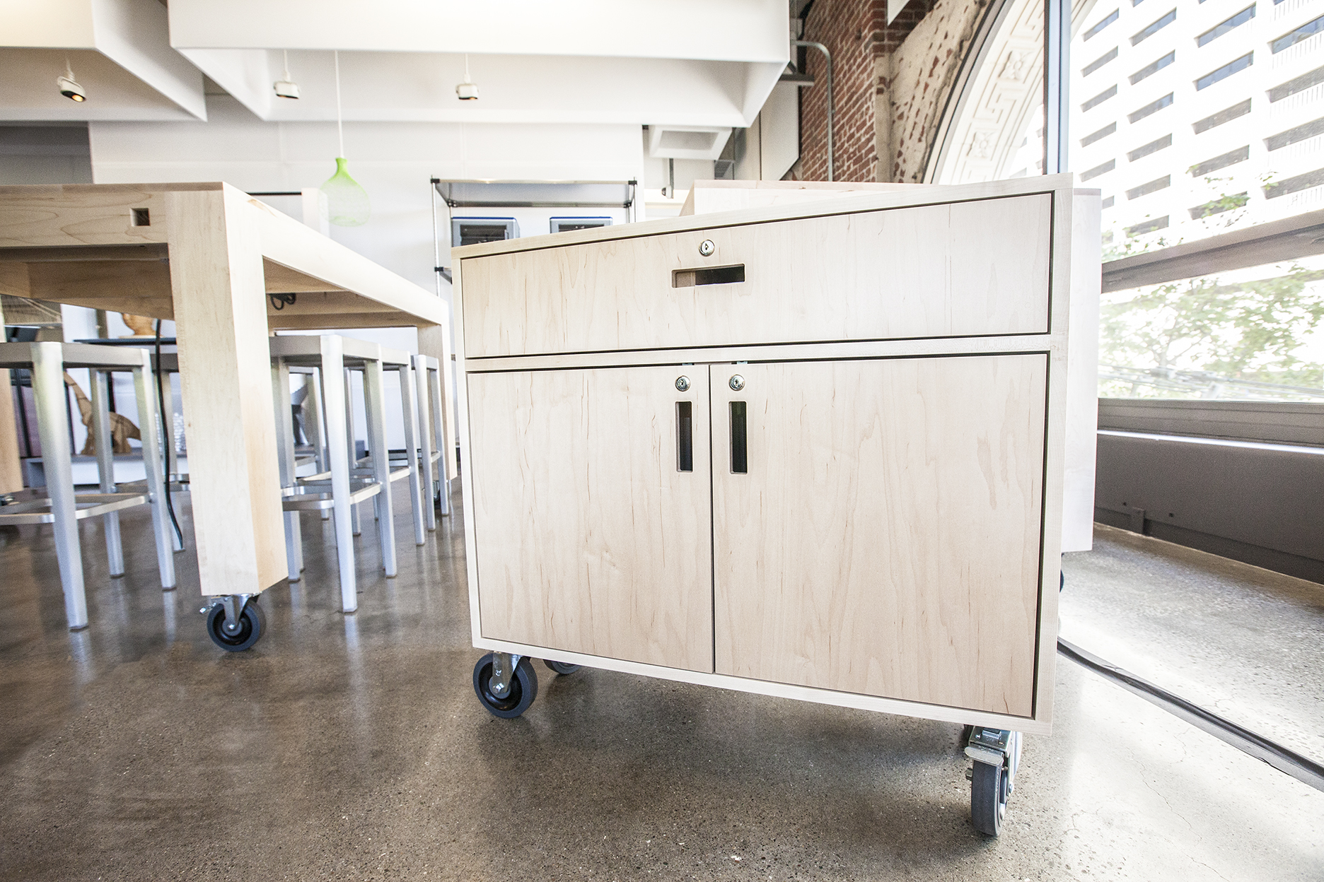 A rolling cabinet designed to hold 14 laptops for the gallery classes.