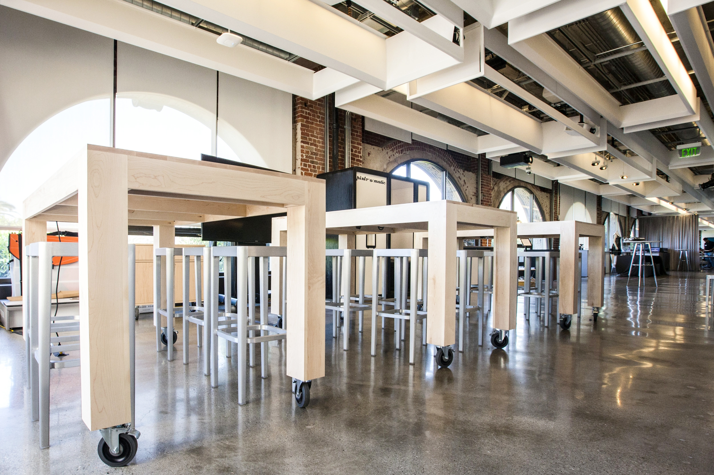 In the SF gallery space, the modern square design of these tables goes well with the interior of the space.