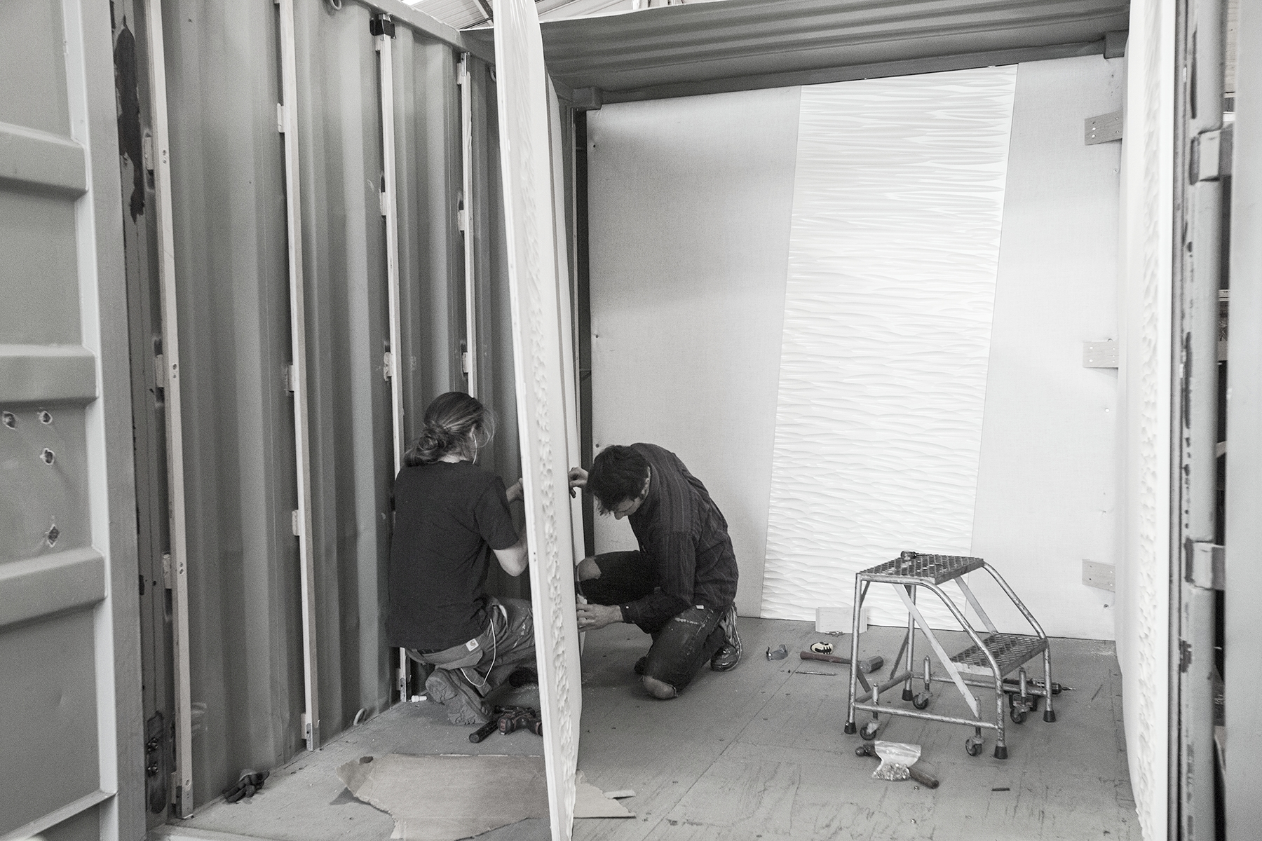 This containers panels are assembled in large units and then attached to create a seemless look.