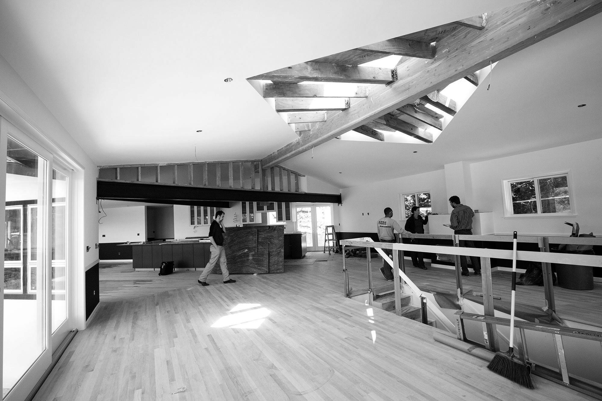 The majority of the construction done, the large open floor plan needs strong structural beams in the ceiling. Again we have kept these exposed. A wooden beam in the dining area and a large steel beam across the kitchen entrance.