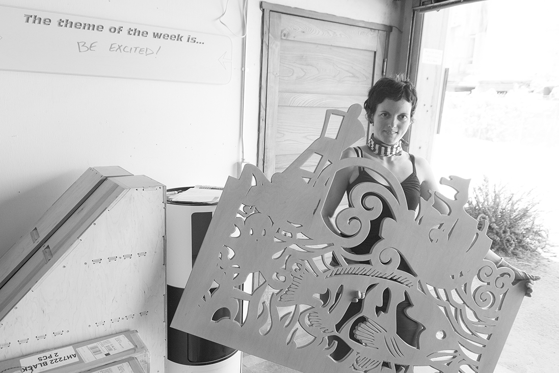 The fabrication of the fun screens, Jillian of BWC, shows off one of the panels.