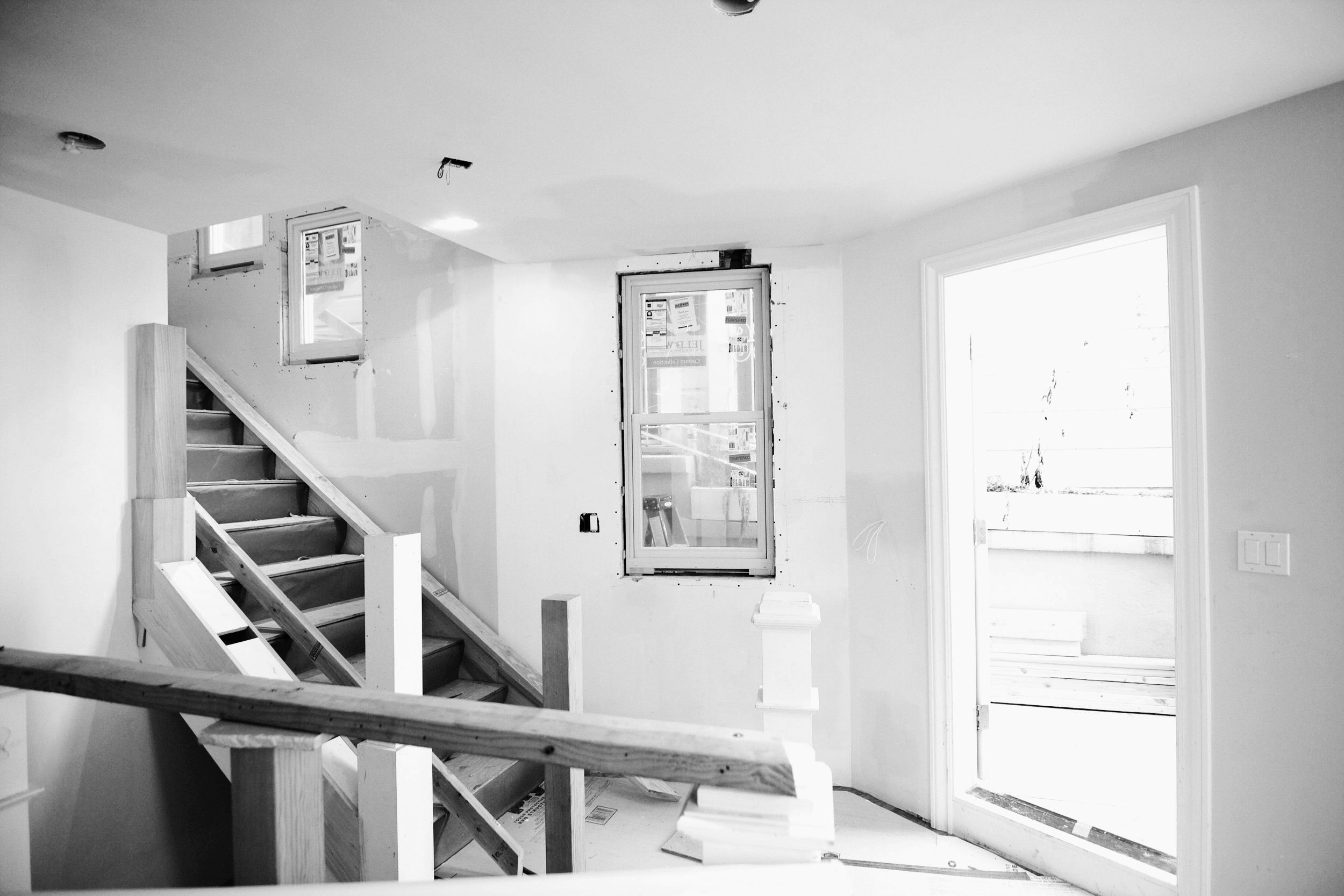 Before, one would have to go outside to access the basement. The new stairs to the lower level basement is now tucked behind the existing stair. By making this minor change, we enabled fluid movement throughout all levels of the home.