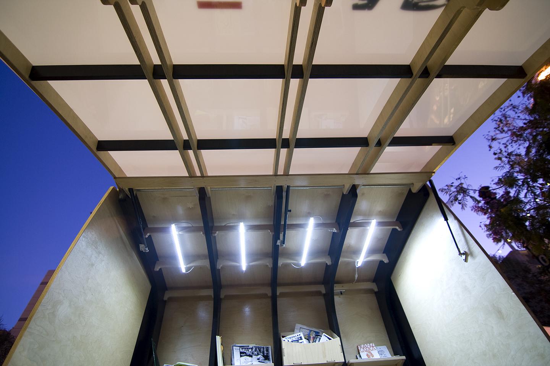 Solar powered LED light strips illuminate the inside.