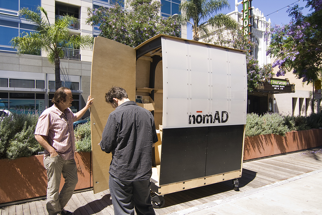 Side door access allows different configurations for the rolling gallery / kiosk.