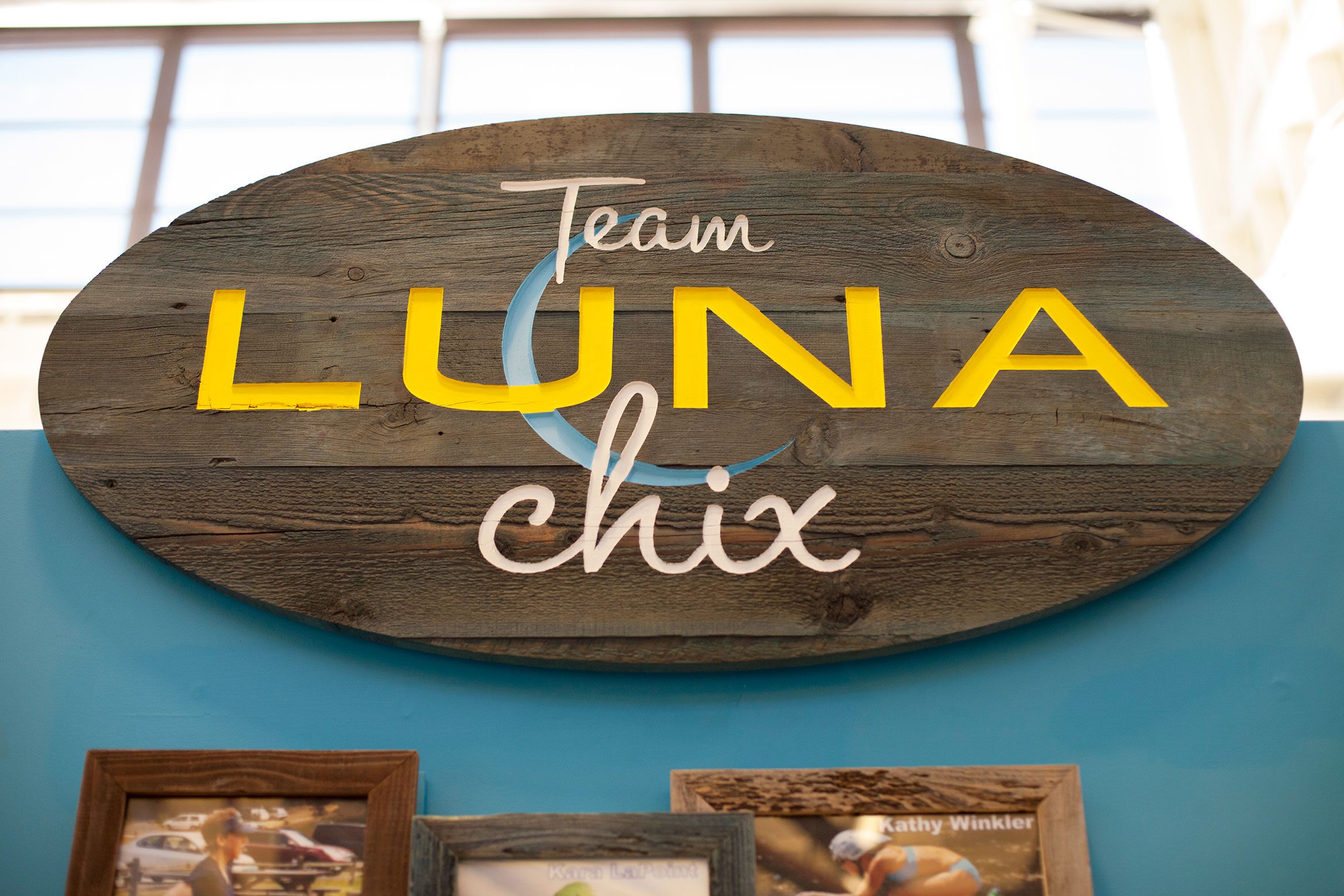 The final Team Luna Chix sign, made on reclaimed boards that were dyed, carved and painted, was exactly the style they wanted.