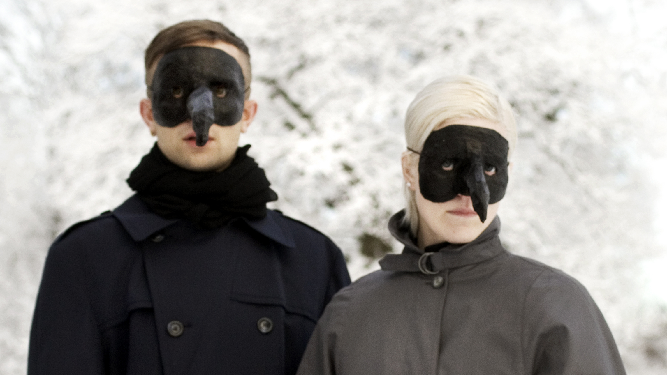 Olof and Karin Dreijer Andersson wearing their iconic Plague Doctor masks.