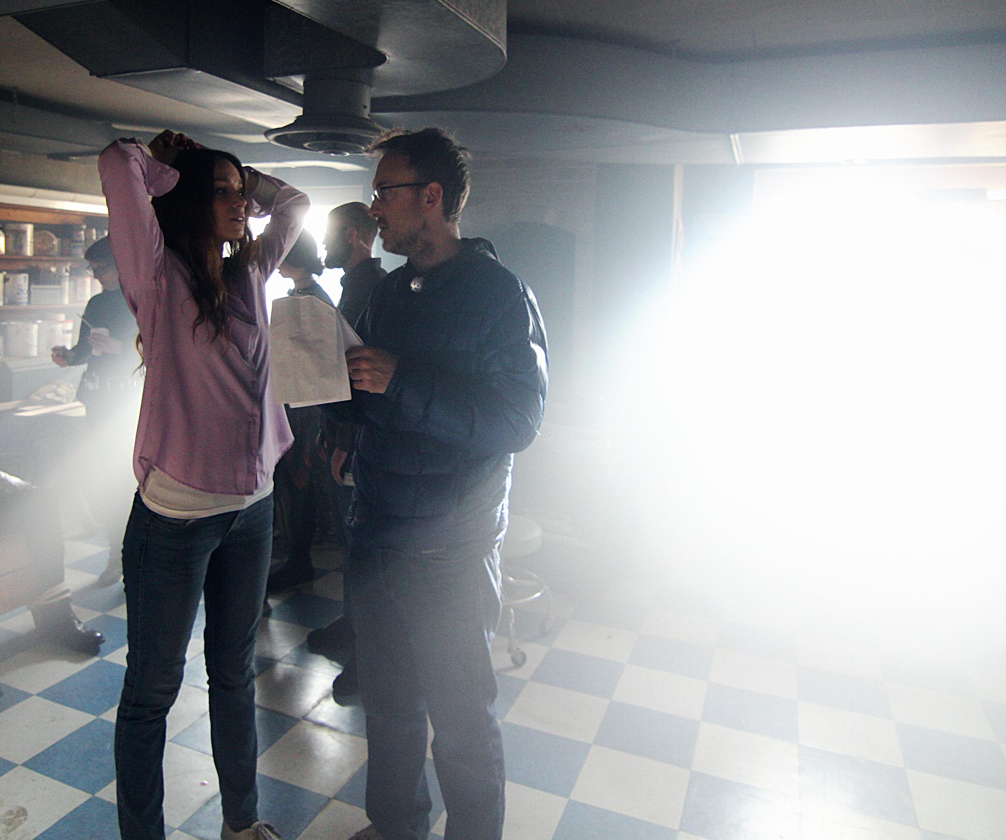 Julius Ramsay and Alex Essoe before a critical scene of home-invasion horror.
