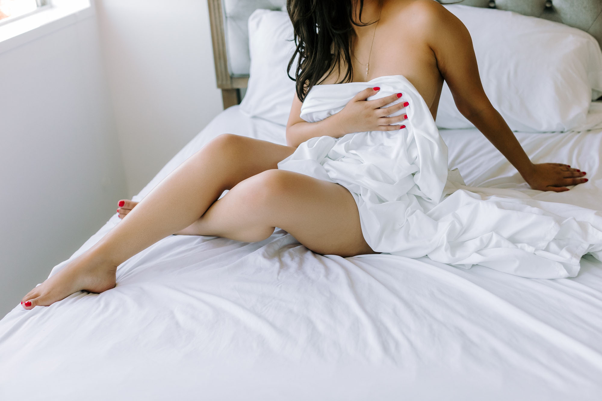 fine_art_nude_boudoir_photography_red_nails_white_sheets_anonymous.jpg